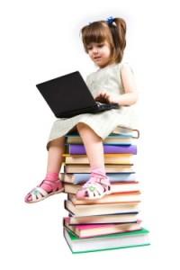 girl_laptop_book_stack